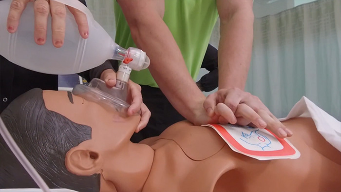 performing CPR on a simulated patient