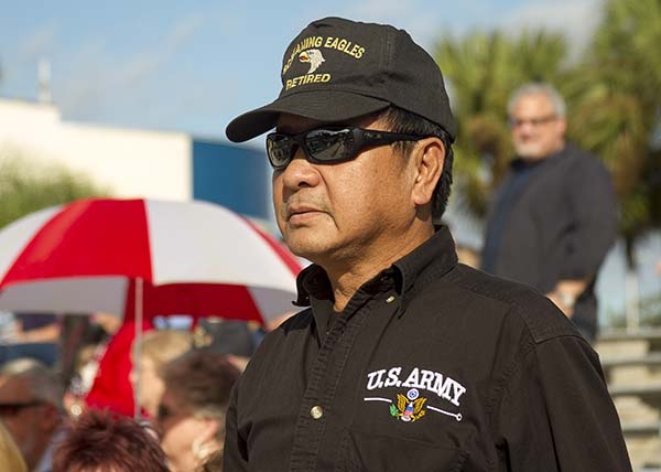 Army veteran wearing army shirt and hat